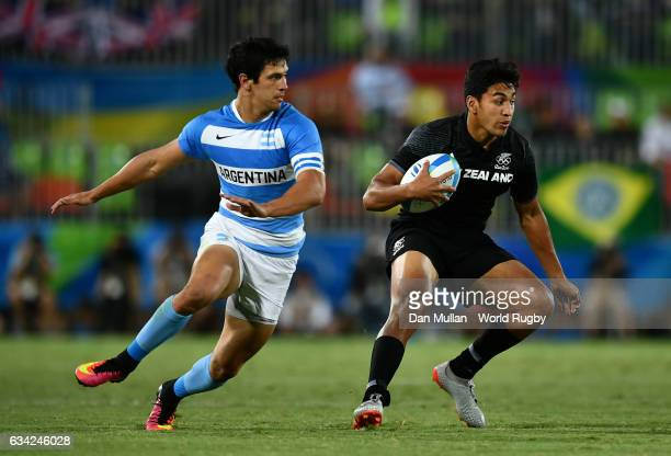 Reiko Ioane of New Zeland steps inside Matias Moroni of Argentina during the Men's Rugby Sevens placing match between New Zealand and Argentina on...