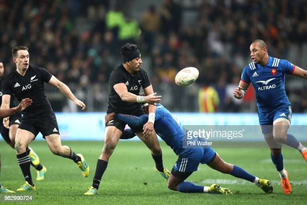 Reiko Ioane of the All Blacks passes during the International Test match between the New Zealand All Blacks and France at Forsyth Barr Stadium on...