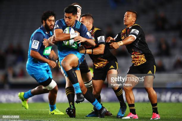 Reiko Ioane of the Blues charges forward during the round 14 Super Rugby match between the Blues and the Chiefs and Eden Park on May 26 2017 in...