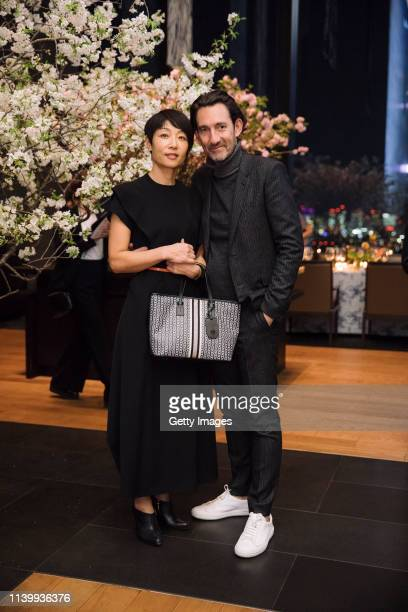 Reiko Miyamoto and Gwenael Nicholas attend the Tory Burch Ginza Boutique Opening After Party on April 02 2019 in Tokyo Japan