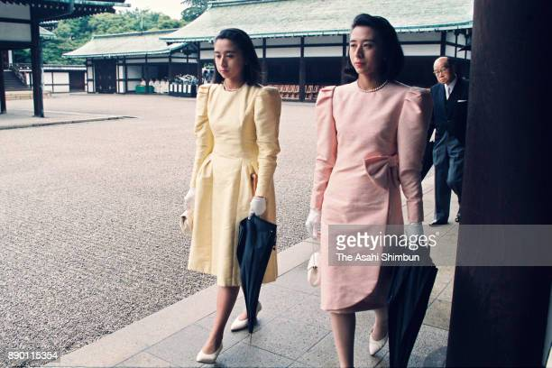 Reiko Owada and Setsuko Owada twin sisters of Masako Owada are seen prior to the royal wedding at the Imperial Palace on June 9 1993 in Tokyo Japan