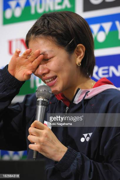 Reiko Shiota of Japan cries at a press conference after losing her mixed doubles match with Shintaro Ikeda of Japan against Muhammad Rijal and...