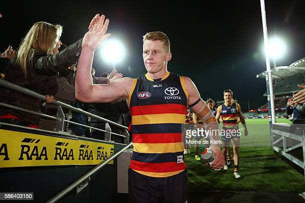 Reilly O'Brien of the Crows leads the team from the field after the Crows won the round 20 AFL match between the Adelaide Crows and the Brisbane...