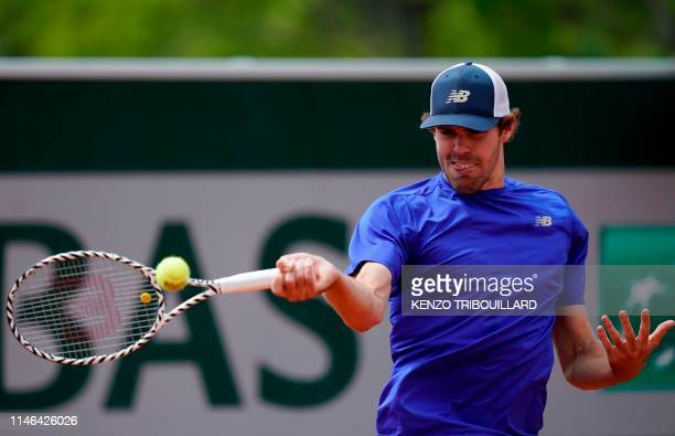 Reilly Opelka of the US returns the ball to Chile's Christian Garin during their men's singles first round match on day two of The Roland Garros 2019...