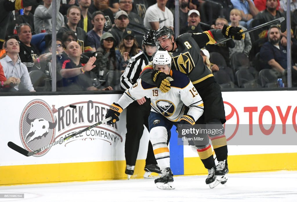 Reilly Smith (R) #19 of the Vegas Golden Knights hits Jake McCabe #19 of the Buffalo Sabres as they chase the puck in the second period of their game at T-Mobile Arena on October 17, 2017 in Las Vegas, Nevada.