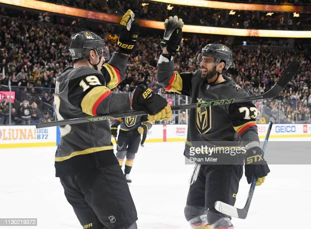 Reilly Smith and Brandon Pirri of the Vegas Golden Knights celebrate after Smith assisted on Pirri's second-period power-play goal against the...
