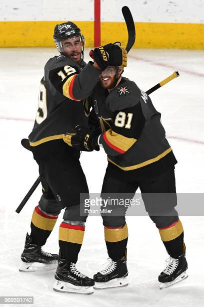 Reilly Smith and Jonathan Marchessault of the Vegas Golden Knights celebrate after they assisted Nate Schmidt on a secondperiod goal against the...