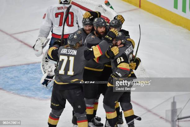 Reilly Smith celebrates his goal with teammates Jonathan Marchessault William Karlsson Deryk Engelland and Shea Theodore of the Vegas Golden Knights...