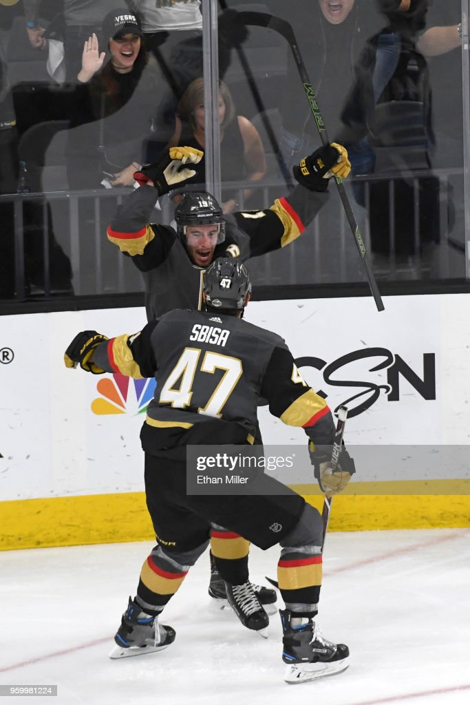 Reilly Smith #19 is congratulated by his teammate Luca Sbisa #47 of the Vegas Golden Knights after scoring a third-period goal against the Winnipeg Jets in Game Four of the Western Conference Finals during the 2018 NHL Stanley Cup Playoffs at T-Mobile Arena on May 18, 2018 in Las Vegas, Nevada. The Golden Knights defeated the Jets 3-2.