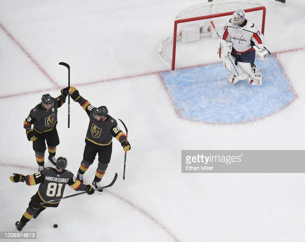 Reilly Smith Jonathan Marchessault and Paul Stastny of the Vegas Golden Knights celebrate after Marchessault and Stastny assisted Smith on a...