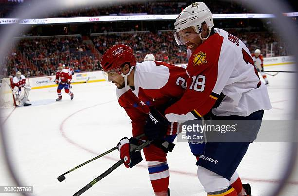 Reilly Smith of the Florida Panthers and Matt Niskanen of the Washington Capitals go after the puck in the first period at Verizon Center on February...