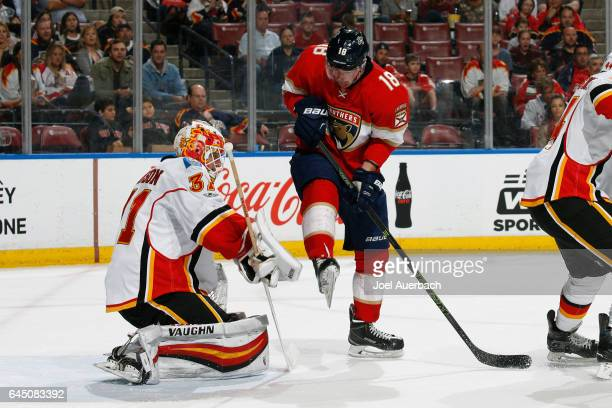 Reilly Smith of the Florida Panthers is unable to tip the puck past goaltender Chad Johnson of the Calgary Flames during first period action at the...