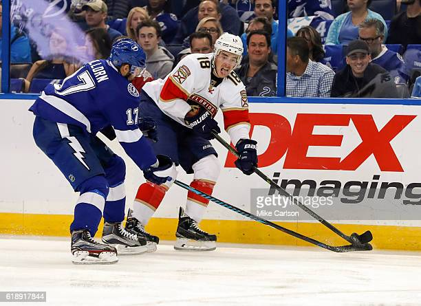 Reilly Smith of the Florida Panthers looks to pass against Alex Killorn of the Tampa Bay Lightningduring the first period at the Amalie Arena on...