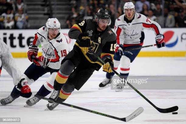 Reilly Smith of the Vegas Golden Knights carries the puck against Nicklas Backstrom of the Washington Capitals during the second period in Game Two...