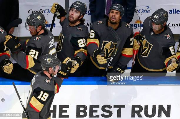 Reilly Smith of the Vegas Golden Knights celebrates a goal against the Chicago Blackhawks with teammates on the bench during the third period in Game...