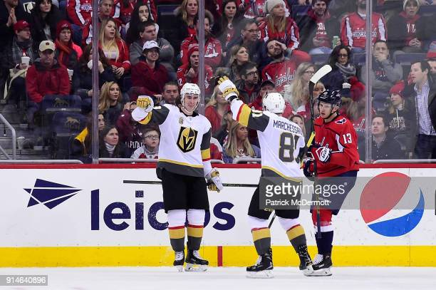 Reilly Smith of the Vegas Golden Knights celebrates with his teammate Jonathan Marchessault after scoring a goal against the Washington Capitals in...