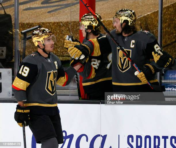 Reilly Smith of the Vegas Golden Knights celebrates with teammates on the bench after scoring a first-period goal against the St. Louis Blues during...