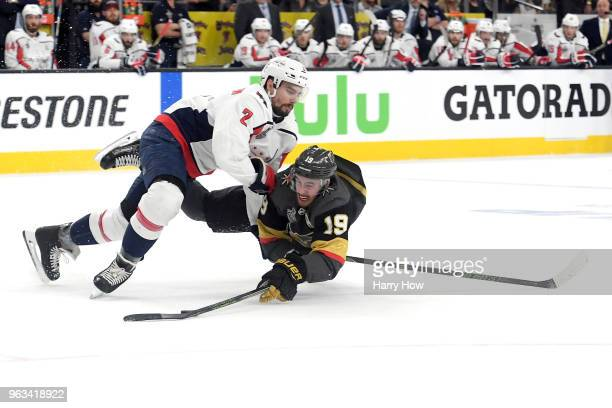 Reilly Smith of the Vegas Golden Knights is checked by Matt Niskanen of the Washington Capitals during the first period during the first period in...
