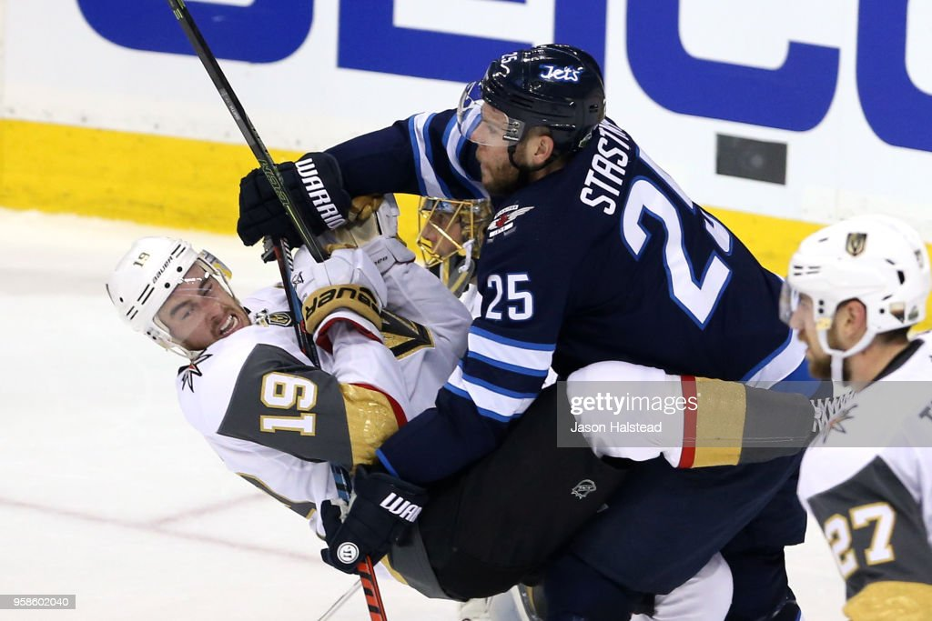 Reilly Smith #19 of the Vegas Golden Knights is checked by Paul Stastny #25 of the Winnipeg Jets during the second period in Game Two of the Western Conference Finals during the 2018 NHL Stanley Cup Playoffs at Bell MTS Place on May 14, 2018 in Winnipeg, Canada.