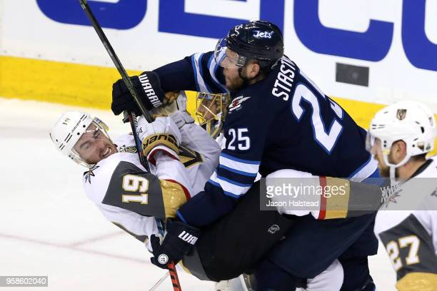 Reilly Smith of the Vegas Golden Knights is checked by Paul Stastny of the Winnipeg Jets during the second period in Game Two of the Western...