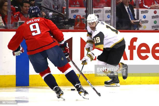 Reilly Smith of the Vegas Golden Knights is defended by Dmitry Orlov of the Washington Capitals during the first period in Game Four of the 2018 NHL...