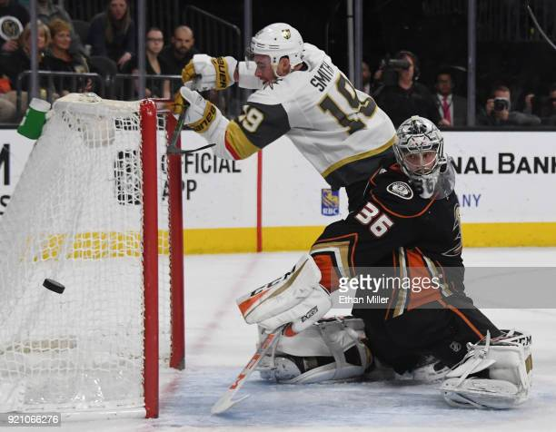 Reilly Smith of the Vegas Golden Knights knocks the goal loose as he trips over John Gibson of the Anaheim Ducks while trying to deflect the puck...
