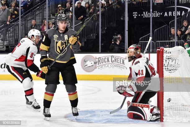 Reilly Smith of the Vegas Golden Knights scores a goal against Cody Ceci and goalie Craig Anderson of the Ottawa Senators during the game at TMobile...