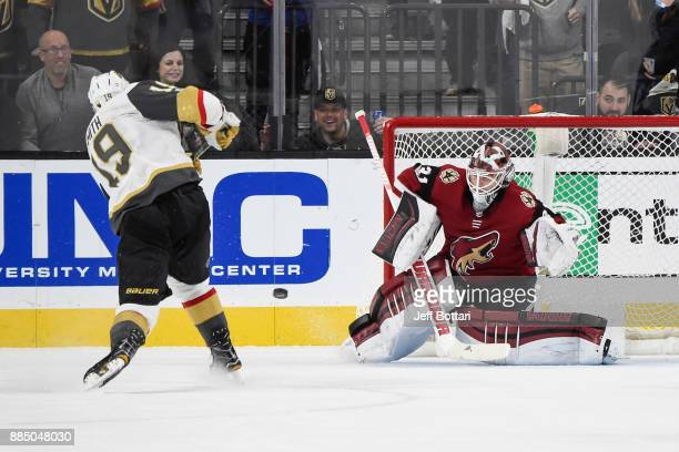 Reilly Smith of the Vegas Golden Knights scores the game winning goal in overtime against Scott Wedgewood of the Arizona Coyotes during the game at...