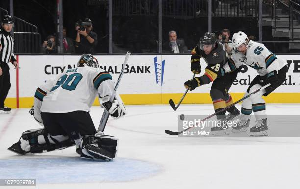 Reilly Smith of the Vegas Golden Knights takes a shot against Aaron Dell of the San Jose Sharks as Erik Karlsson of the Sharks defends in the second...