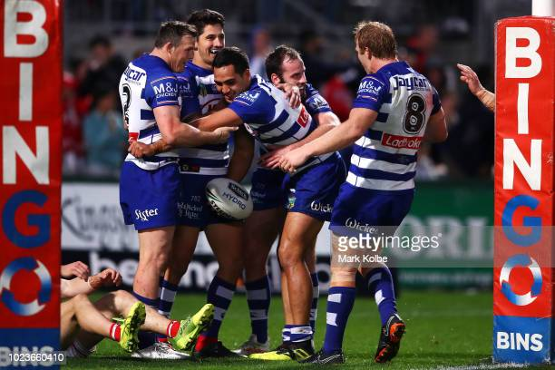 Reimis Smith of the Bulldogs celebrates with his team mates after scoring a try during the round 24 NRL match between the St George Illawarra Dragons...