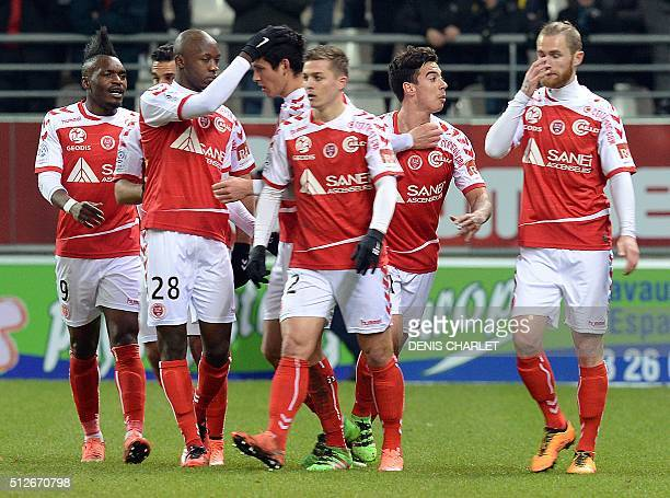 Reims' Algerian defender Aissa Mandi celebrates with teammates after scoring a goal during the French L1 football match between Reims and Bordeaux at...