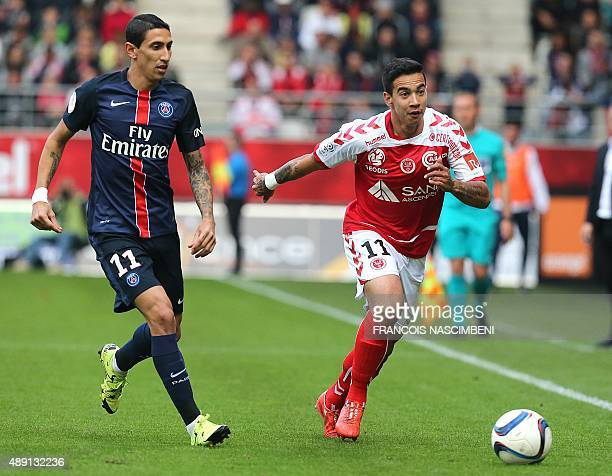 Reims' Brazilian midfielder Diego Rigonato vies with PSG's midfielder Angel Di Maria during the French Ligue 1 football match between Reims and Paris...