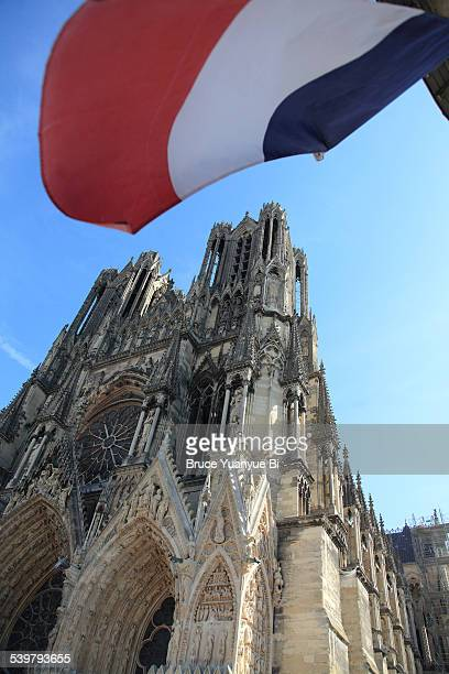 Reims Cathedral with a French flag