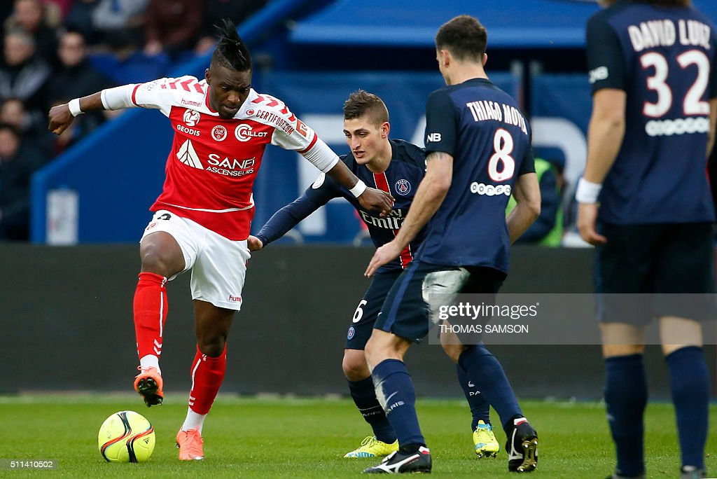 Reims' Congolese forward Thievy Bifouma challenges Paris Saint-Germain's Italian midfielders Marco Verratti (C) and Thiago Motta during the French L1 football match between Paris Saint-Germain (PSG) and Reims at the Parc des Princes stadium in Paris on February 20, 2016.