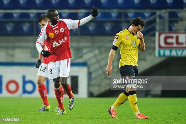 Reims' Congolese midfielder Prince O'Niangue celebrates after scoring a goal during the French L1 football match between Sochaux and Reims at the...