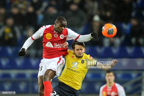 Reims' Congolese midfielder Prince O'Niangue jumps to head the ball with Sochaux's Bosnian midfielder Sanjin Prcic during the French L1 football...