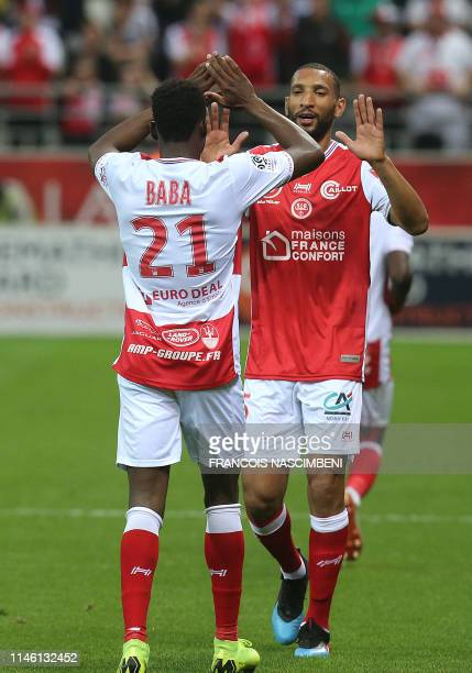 Reims' defender Abdul Rahman Baba celebrates after scoring a goal during the French Ligue 1 football match between Reims and Paris SaintGermain at...