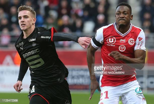 Reims' defender Abdul Rahman Baba vies for the ball with Rennes' French midfielder Benjamin Bourigeaud during the French L1 football match between...