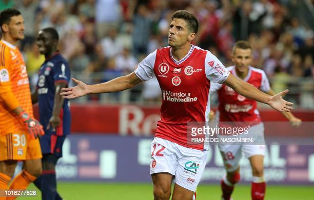 Reims' forward Pablo Chavarria celebrates after scoring a goal during the L1 football match ReimsLyon on August 17 2018 at the Auguste Delaune...