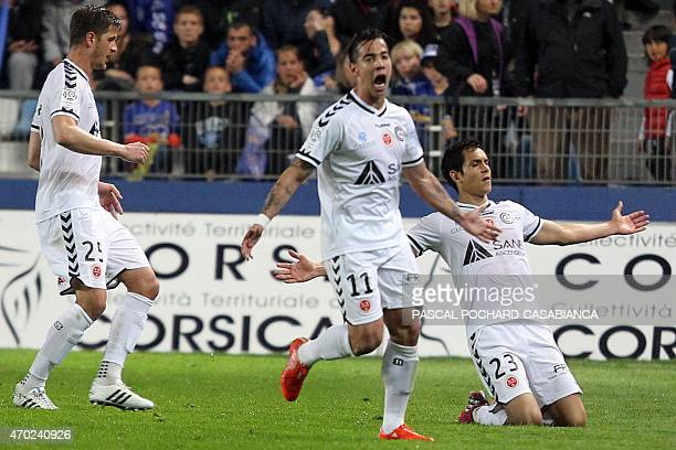 Reims' French Algerian defender Aissa Mandi celebrates after scoring a goal during the French L1 football match Bastia against Reims on April18 2015...