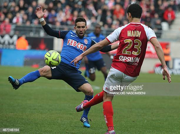Reims' French Algerian defender Aissa Mandi vies with Monaco's Portuguese midfielder Joao Moutinho during the French Football match between Reims and...