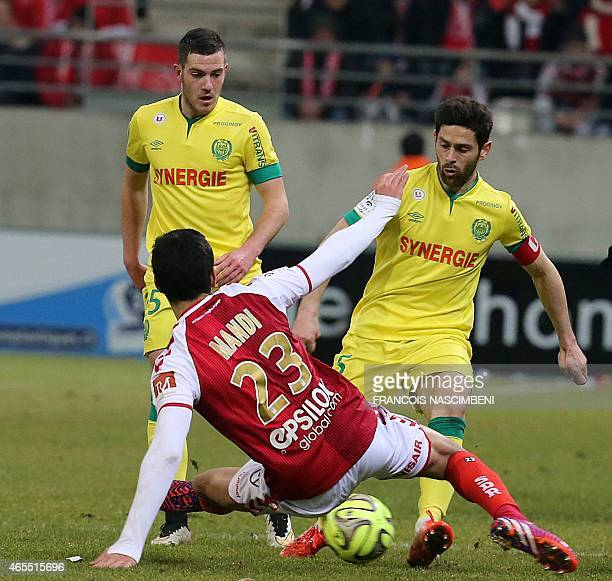 Reims' French Algerian defender Aissa Mandi vies with Nantes' French defender Olivier Veigneau during the French L1 football match Reims vs Nantes on...