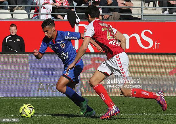 Reims' French Algerian defender Aissa Mandi vies with Nice's forward Mohamed Benrahma during the French L1 football match between Reims and Nice on...