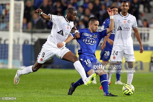 Reims' French Congolese midfielder Prince Oniangue vies with Bastia's Franco Algerian midfielder Ryad Boudebouz during the French L1 football match...