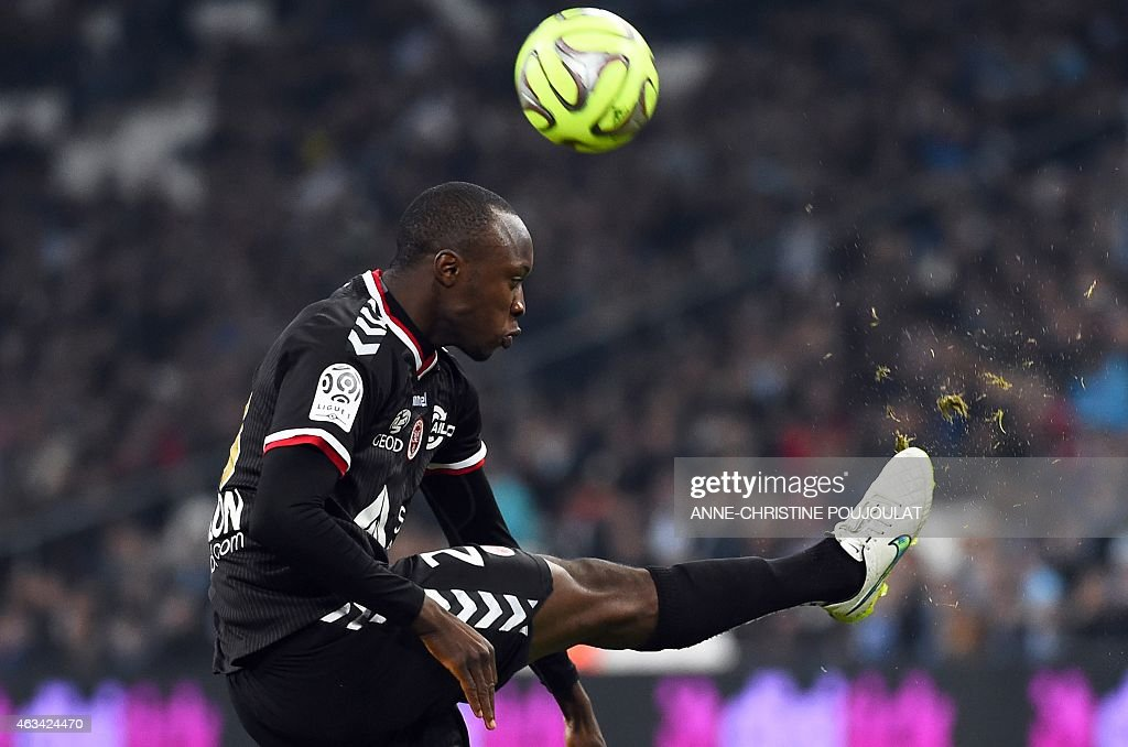 Reims' French defender Antoine Conte shoots the ball during the French L1 football match Marseille vs Reims on February 13, 2015 at the Velodrome stadium in Marseille, southern France.