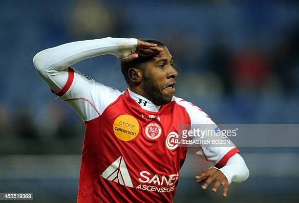 Reims' French defender Christopher Glombard celebrates after scoring a goal during the French L1 football match between Sochaux and Reims at the...