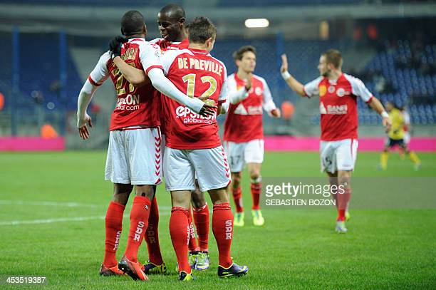 Reims' French defender Christopher Glombard celebrates with teammates after scoring a goal during the French L1 football match between Sochaux and...