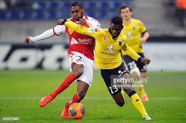 Reims' French defender Christopher Glombard challenges Sochaux's French midfielder Abdoul Razzagui Camara during the French L1 football match between...