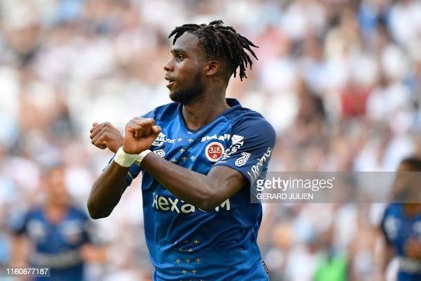 Reims' French forward Boulaye Dia celebrates after scoring a goal during the French L1 football match between Olympique de Marseille and Stade de...