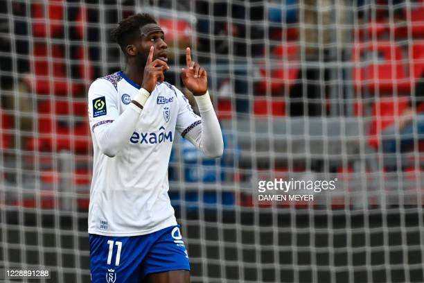 Reims French forward Boulaye Dia celebrates after scoring during the French L1 football match between Stade Rennais Football Club and Stade de Reims...